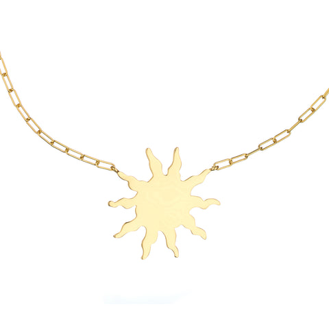 Sun talisman hung from thick gold chain
