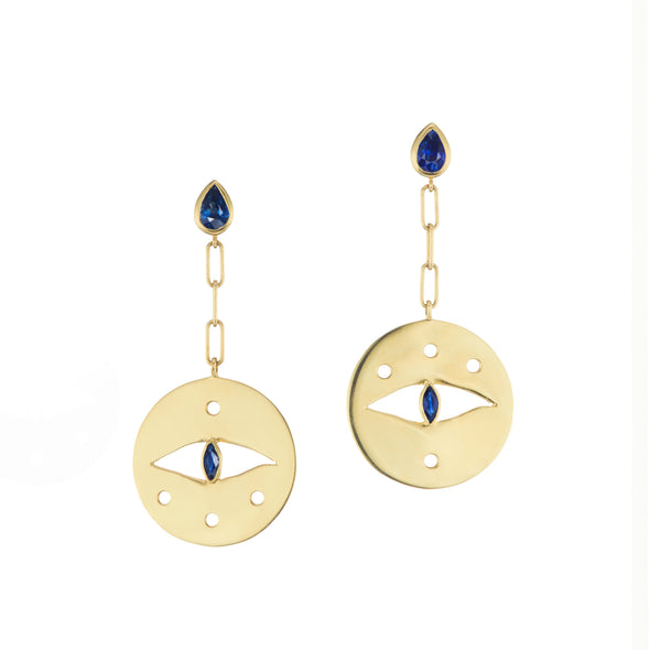 Gold earrings with blue sapphire detailing on earrings.