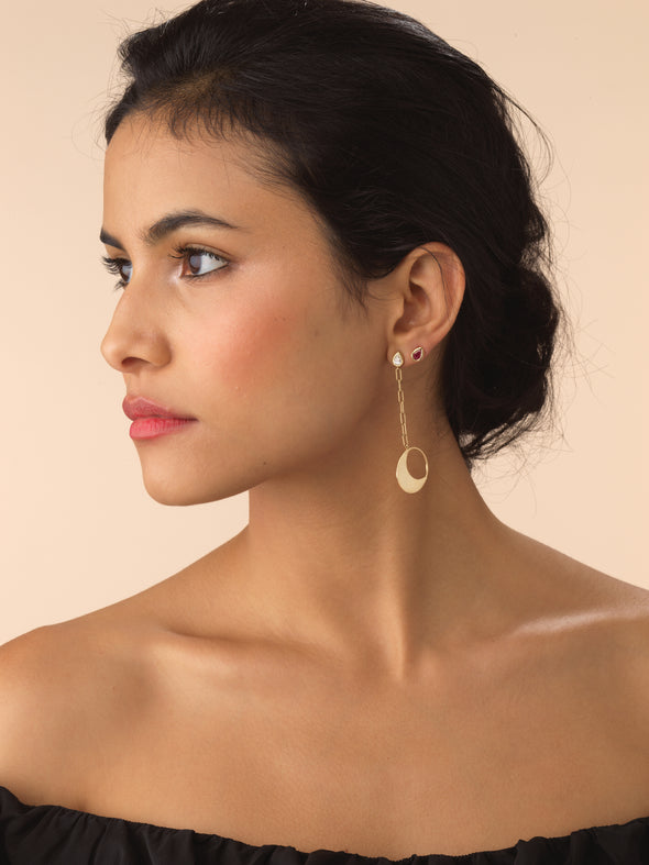 Model wearing gold moon earrings with diamond stud detailing