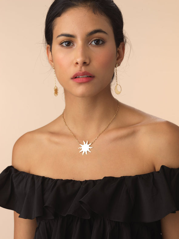 Model wearing Big Sun Necklace in gold