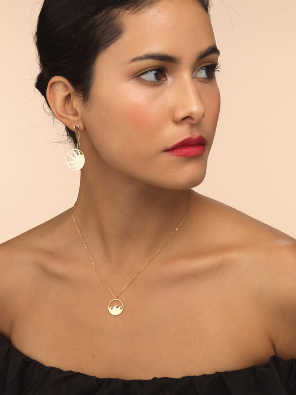 Model wearing gold small wave necklace