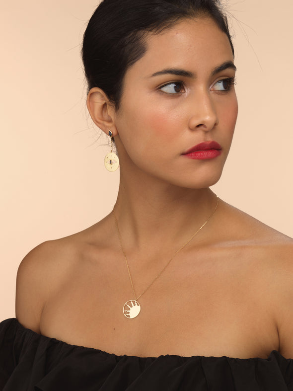 Model wearing half sun gold necklace