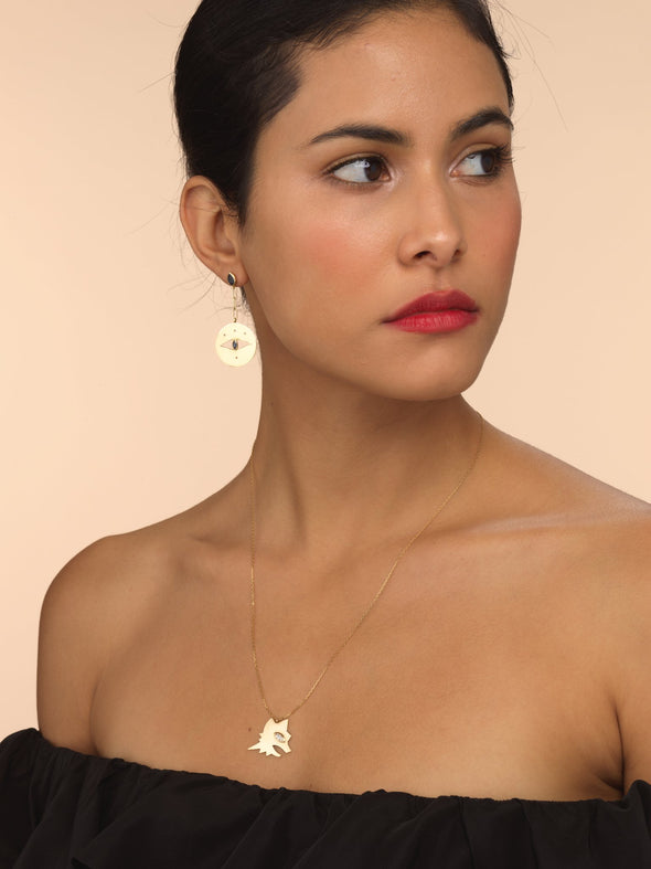 Model wearing gold Lupa necklace