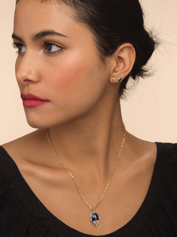 Model wearing lady luck ladybug necklace in gold and enamel.
