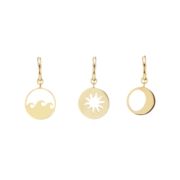 Gold pirate earrings in wave, sun and moon.