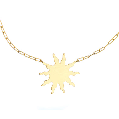 Handmade gold sun necklace with symbolic charm pendant