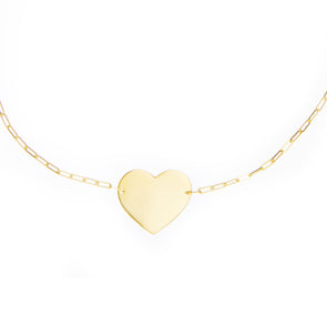 Handmade gold necklace with symbolic heart charm