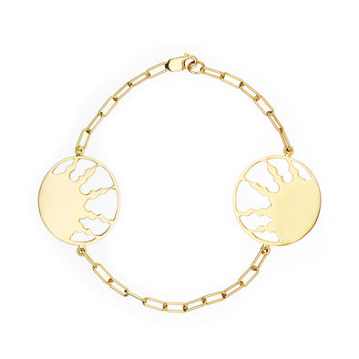 Handmade gold bracelet with two symbolic sun charms.