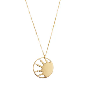 Handmade gold necklace with half sun cutout at pendant