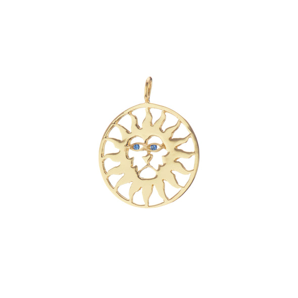 Gold pendant shaped as sun lion with blue sapphire eyes.