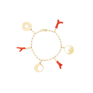 Handmade gold bracelet with gold talismans and red coral charms.