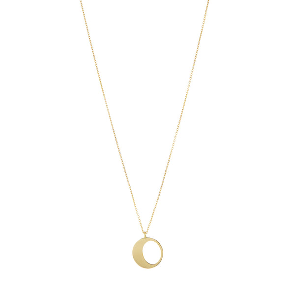 Handmade gold necklace with small moon pendant.