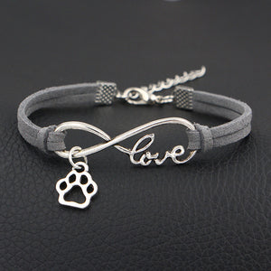 Paw print infinity leather bracelet. Buy one get one free using discount code GETONEFREE