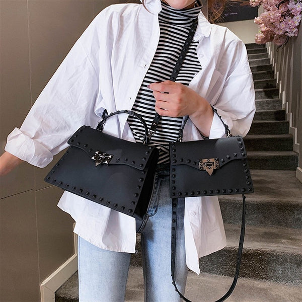 The Studded Crossbody Messenger Bag Combines Cool Style with Classic Charm!