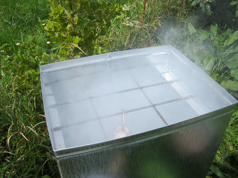 trout smoking in outdoorcook fish smoker
