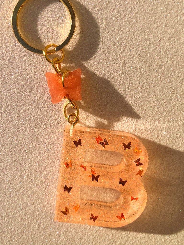 ORANGE BUTTERFLY LETTER KEYCHAIN