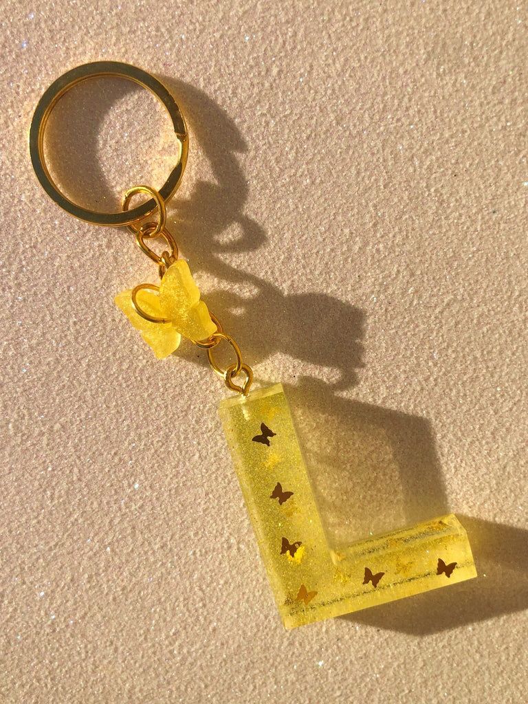 YELLOW BUTTERFLY LETTER KEYCHAIN