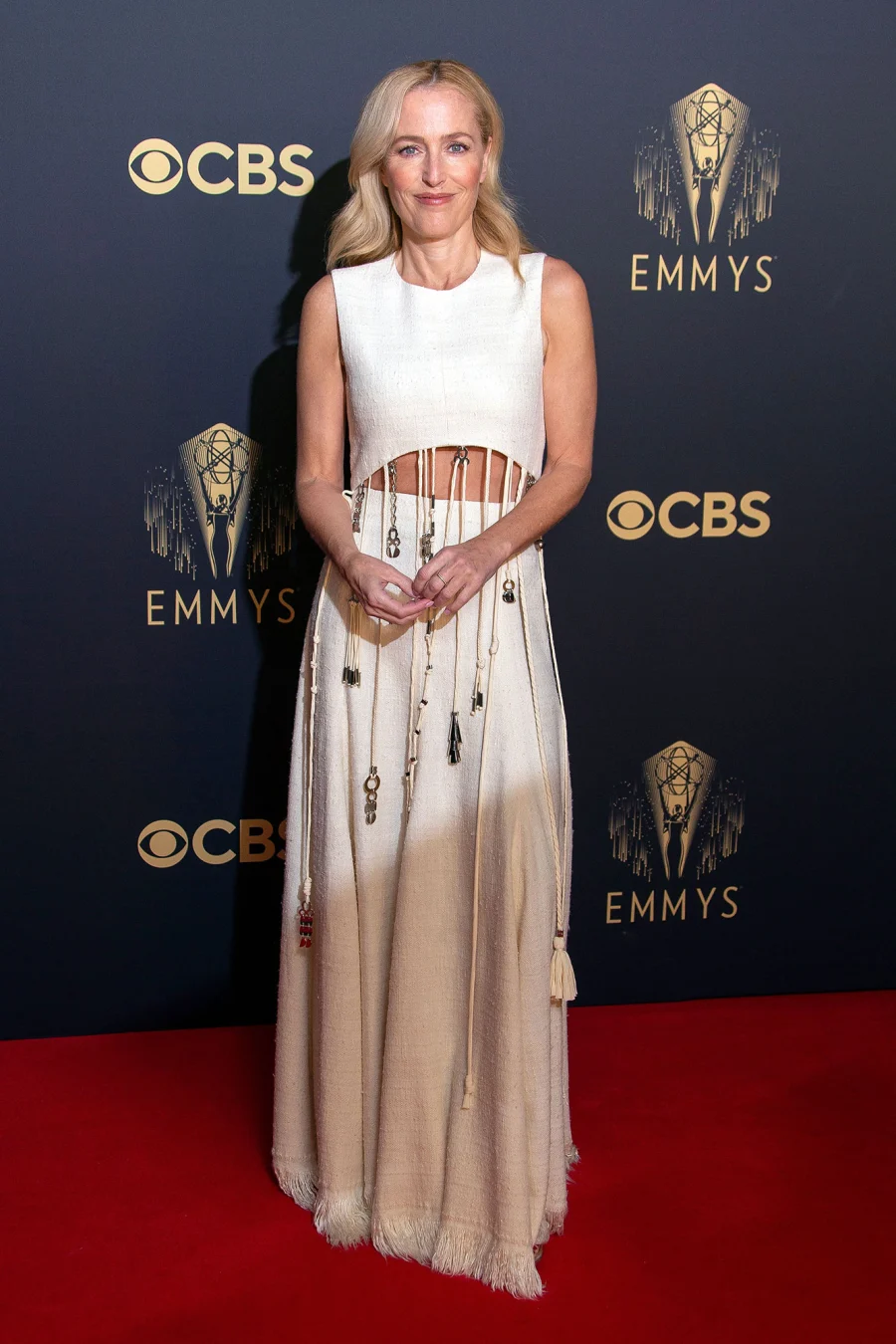 Gillian Anderson wearing two piece white cut out dress on Emmys red carpet