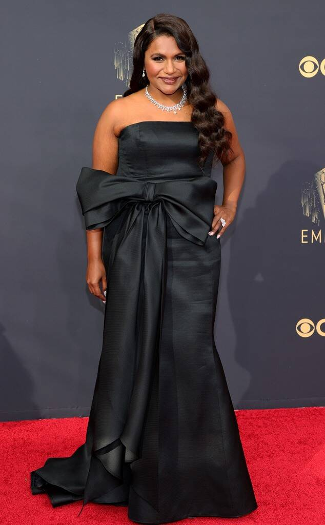 Mindy Kaling in black floor length dress with bow