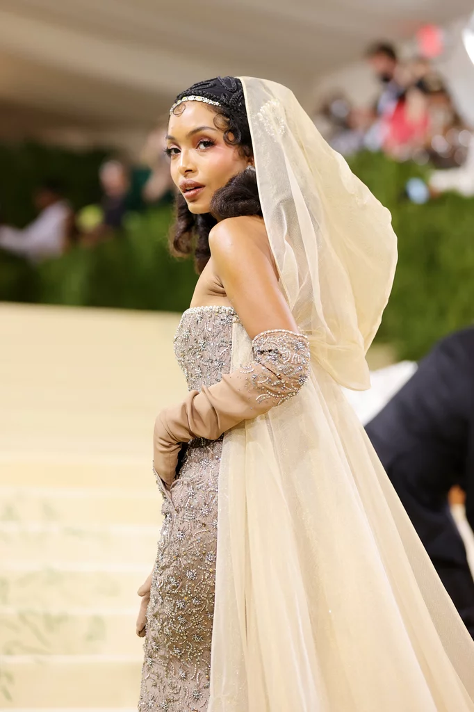 Yara Shahid wearing yellow gold sequinned gown and gold veil