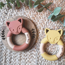 Load image into Gallery viewer, Silicone and beechwood fox face teething ring in mustard and cinnamon on a natural background.