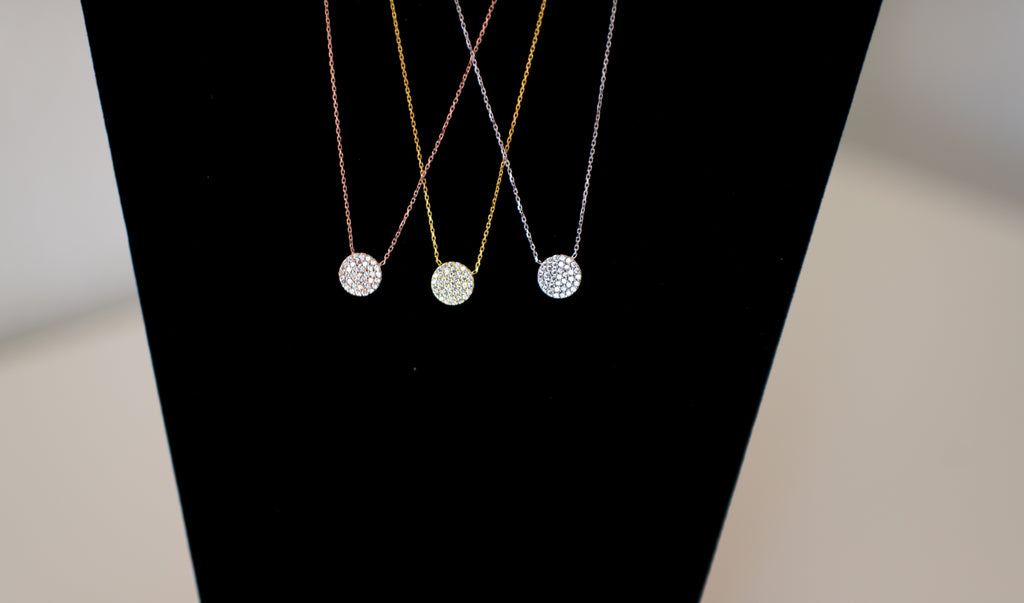 Sterling Silver chain accented by a 10 mm CZ Disc