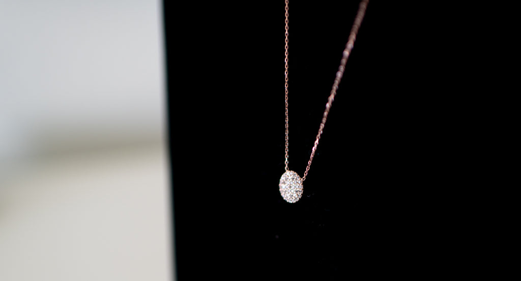14kt Rose Gold filled chain accented by a 10 mm CZ Disc