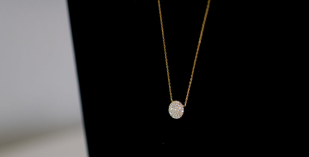 14kt Yellow Gold filled chain accented by a 10 mm CZ Disc