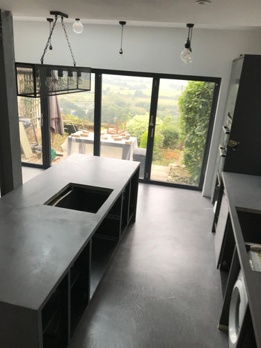 Polished concrete microcement floor and worktops