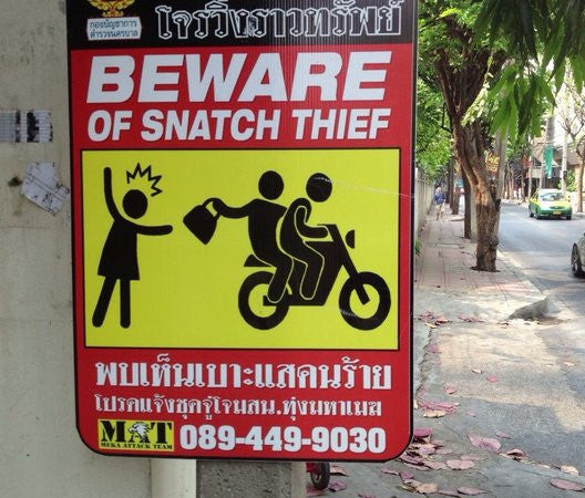 Motorbike snatch thief