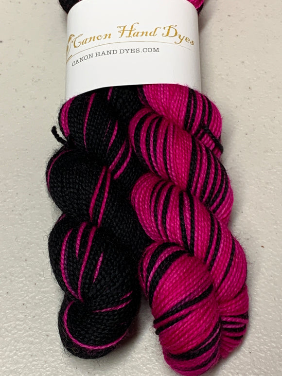 IMPERFECT PINK & Black Polar Opposites Self-Striping; Charles Merino Fingering Yarn