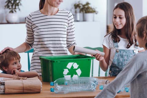 woman teaching children about waste management