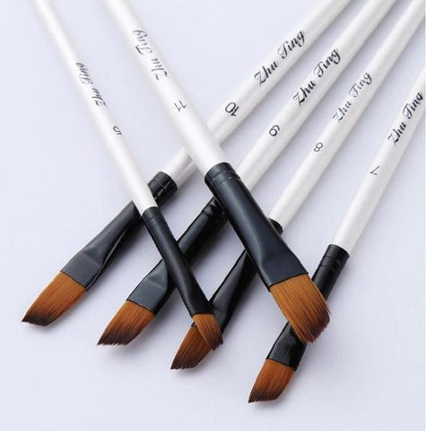 set-of-white-paintbrushes