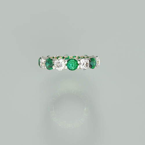 Eternity diamond and emerald ring