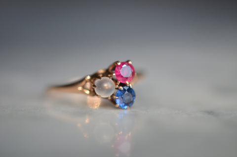 Delicate Moonstone, Ruby, and Sapphire Clover Ring