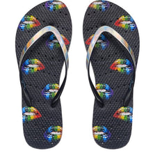 Load image into Gallery viewer, Image of shower flip flops with rainbow colored lips on a black sole. Made by Showaflops