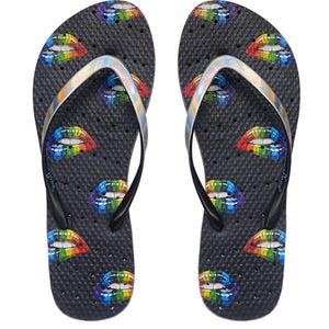 Image of shower flip flops with rainbow colored lips on a black sole. Made by Showaflops