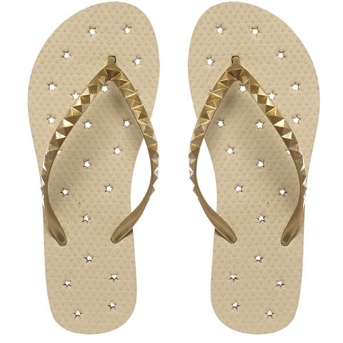 Image of shower flip flop featuring a Neutral sand-colored footbed with a metallic gold stud strap. Drainage hole pattern make for a perfect non-skid flip flop.