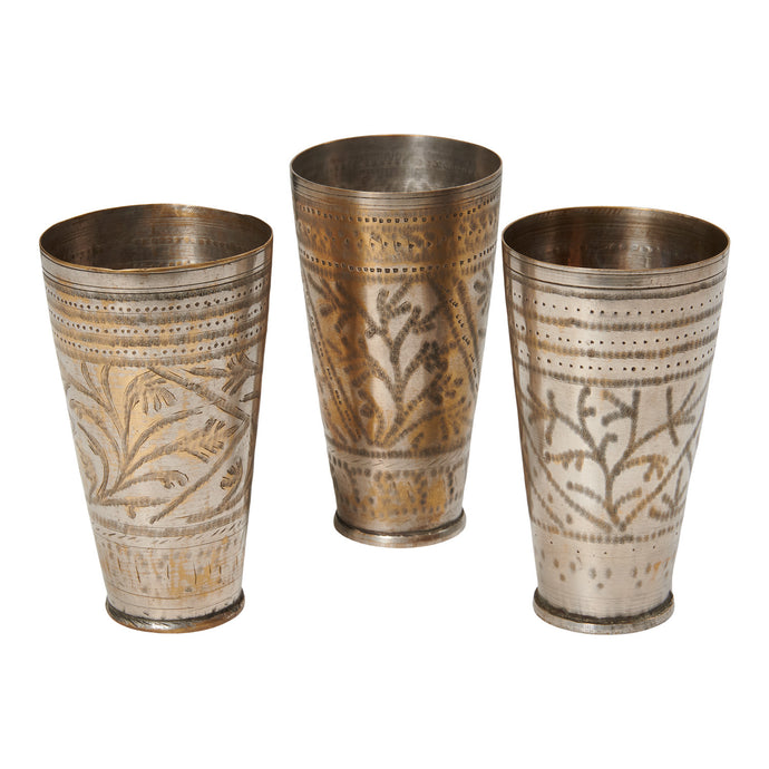 Hand engraved vintage cup made of metal and brass. Originally in India used to serve lassi in, a popular yoghurt drink. Each item is unique. Style them in your kitchen or cabinet with utensils or beautiful flowers