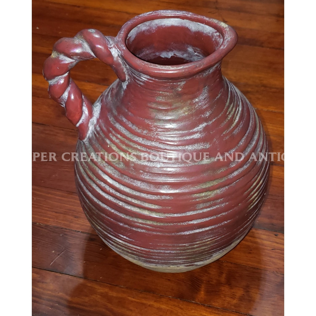 Clay Vase With Twisted Handle