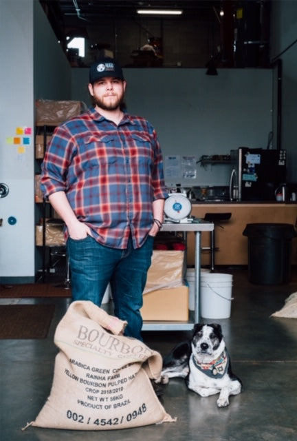 John Lynn, Head Roaster at Hugo Coffee Roasters with his rescue dog Rivers