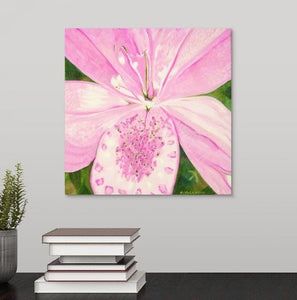 A painting, by fine artist Nancy McLennon, of light pink lily in a green garden background hanging over a desk