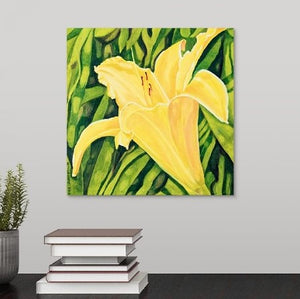 A painting, by fine artist Nancy McLennon, of a single yellow lily in a green garden hanging over a desk