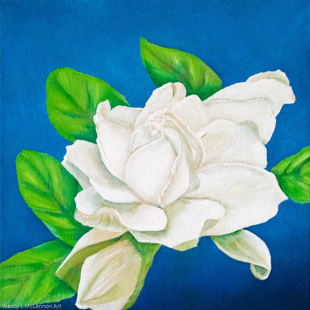A painting, by fine artist Nancy McLennon, of a single white gardenia bloom on a deep blue background