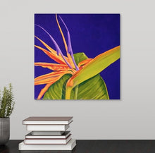 Load image into Gallery viewer, A painting, by fine artist Nancy McLennon, of a bright orange and purple 'Bird of paradise' bloom, surrounded by a deep, dark solid purple background hanging over a desk