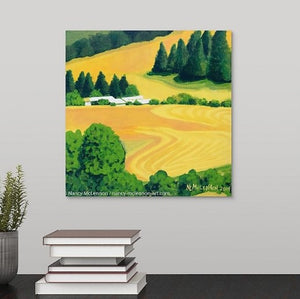 A painting of a sunny golden rows of harvested Washington State farm fields, white farm buildings which are surrounded by green trees hanging over a black desk