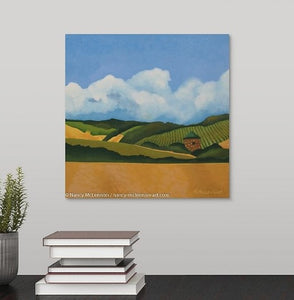 A painting of a Napa Valley, CA vineyard with golden hills and a stone hut with a copper roof hanging over a black desk