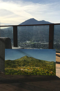 Work in progress of Nancy McLennon painting of Mt Tamalpais, the landmark of Marin County, as the morning sun rises, under a clear blue sky.