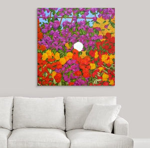 A painting by fine artist Nancy McLennon of blooming spring floral garden filled with bougainvillea, red roses, yellow roses, and hydrangea blooms on a background of wooden lattice and blue sky hanging over a white couch