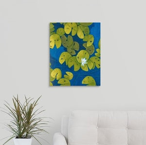 A painting, by fine artist Nancy McLennon, of a deep blue & aqua blue pond with floating golden yellow lily pads and white flower blooms hanging over a couch